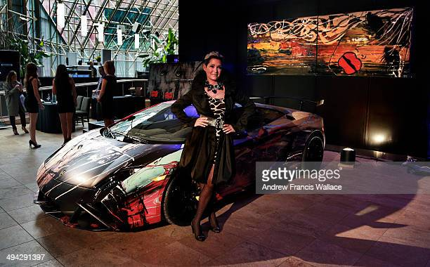 TORONTO ON MAY 1 Artist Lisabel and her art wrapped Lamborghini art car for the cover of Luxury Wheels special section about 'bling' May 1 2014