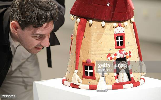Artist Lou Romano looks at a piece on display during a press preview of the Metropolitan Opera's and The New Yorker's exhibition of Hansel and Gretel...