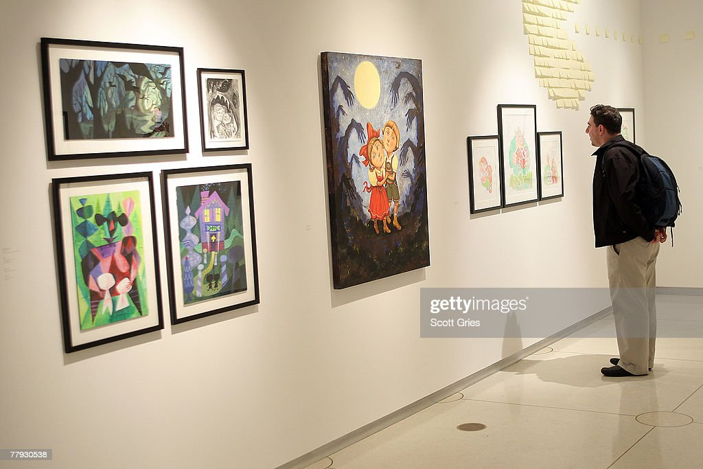 Artist Lou Romano looks at a piece on display during a press preview of the Metropolitan Opera's and The New Yorker's exhibition of 'Hansel and Gretel' at the Arnold & Marie Schwartz Gallery Met on November 15, 2007 in New York City.