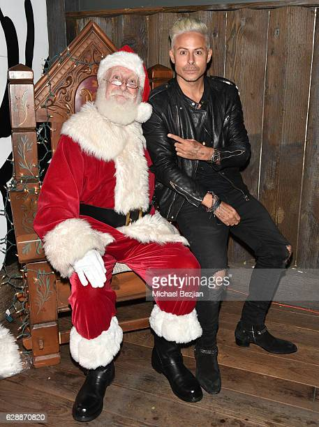 Artist Louis Carreon and Santa at Not For Sale x Z Shoes Benefit at Estrella Sunset on December 9, 2016 in West Hollywood, California.