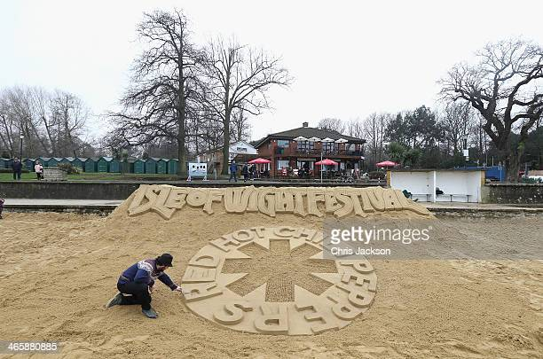 Artist Luc Valvona puts the finishing touches to his Sand Sculpture as the the Isle of Wight Festival unveil a 10m long sand sculpture on the beach...
