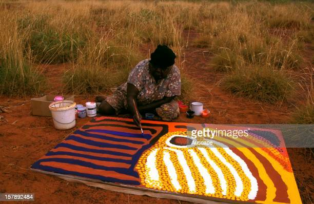 Artist Lucy Yukenbarri with her painting Tjuriltjarra depicting some of the past country the Great Sandy Desert main features waterhole dunes and...