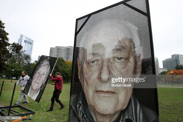 Artist Luigi Toscano far left and his crew set up large photographic portraits of Holocaust survivors in the Boston Common on Oct 15 2018 as part of...