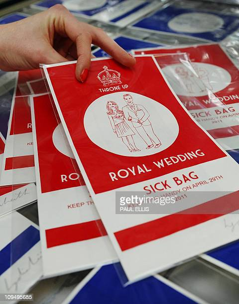 Artist Lydia Leith displays some examples of her printed 'Royal Wedding Sick Bags' produced to commemorate the wedding of Britain's Prince William to...