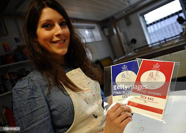 Artist Lydia Leith poses with examples of her printed 'Royal Wedding Sick Bags' produced to commemorate the wedding of Britain's Prince William to...