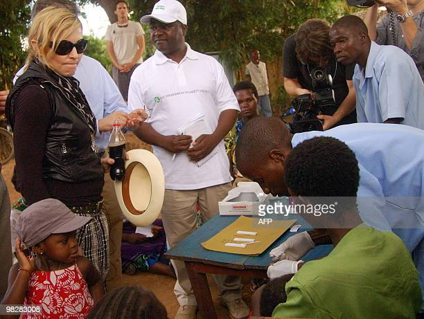 US artist Madonna and her adopted daughter Mercy James visit a mobile clinic where children are being screened for Malaria during a visit to Gumulira...