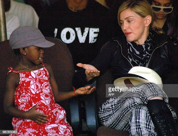 US artist Madonna plays with her adopted daughter Mercy James during a visit to Gumulira Millenium villages in Mchinji west of the capital Lilongwe...
