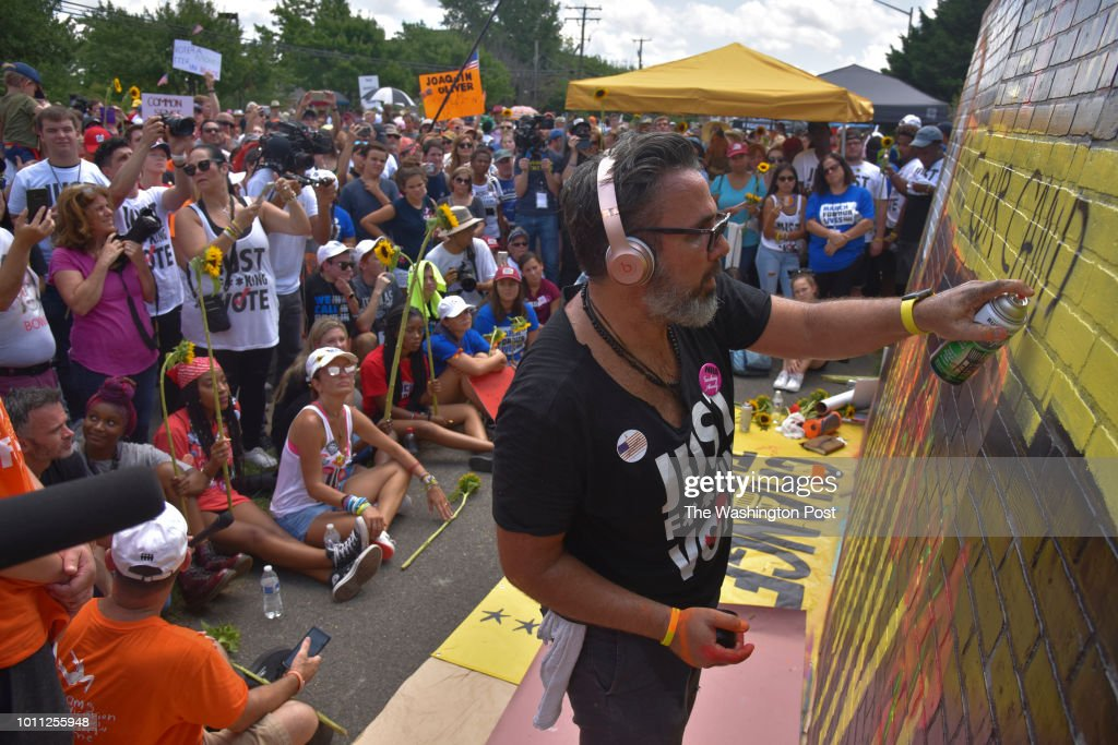 Artist Manuel Oliver paints an impromptu mural in honor of his slain son, Joaquin Oliver, a recent Florida school shooting victim, as various gun control organizations - including The National Organization For Change, March For Our Lives, and Team Enough - hold a demonstration on the street in front of the National Rifle Association (NRA) Headquarters in FairFax, VA, on Saturday, August 4, 2018, in Fairfax, VA. The 'March On NRA' is an event to highlight the battle faced by people of the United States as they seek to live in a world without the fear of gun violence. Included are organizations such as Youth Over Guns, WeCanVote, NoRA, Women's March, Gays Against Guns, MoveOn, Giffords Courage Fellowship, Guns Down, Families Belong Together and Youth Empower.