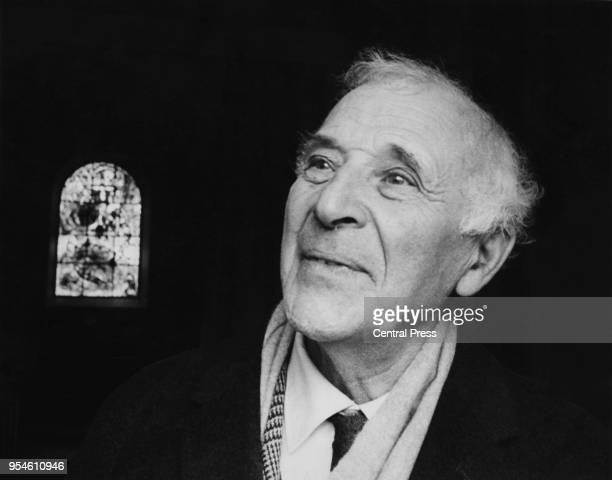 Artist Marc Chagall in front of a stained glass window he designed at All Saints' Church in Tudeley, Kent, 18th November 1967.