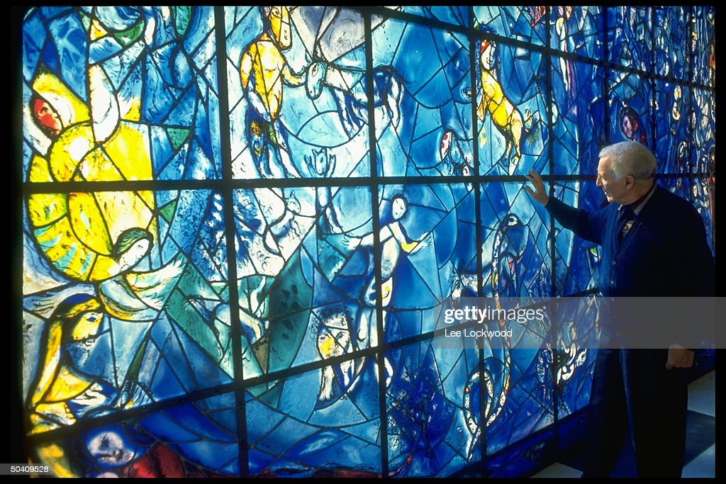 Artist Marc Chagall (R) touching his stained glass window installed at the United Nations.