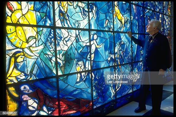 Artist Marc Chagall viewing his stained glass window installed at the United Nations.