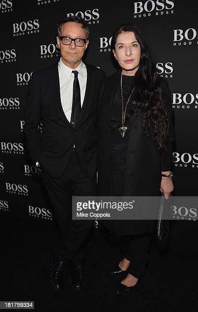 Artist Marco Brambilla and Marina Abramovic attend HUGO BOSS celebrates Columbus Circle BOSS flagship opening featuring premiere of 'Anthropocene' by...