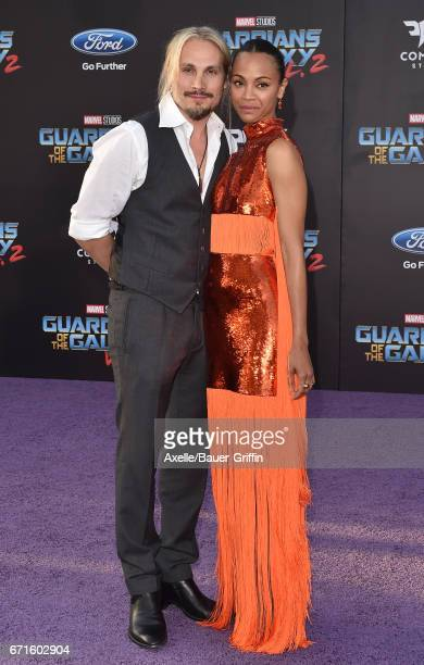 Artist Marco Perego and actress Zoe Saldana arrive at the premiere of Disney and Marvel's 'Guardians of the Galaxy Vol. 2' at Dolby Theatre on April...