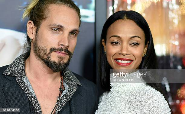 Artist Marco Perego and actress Zoe Saldana arrive for the for the world premiere of Warner Bros Live By Night January 9 2017 at the TCL Chinese...