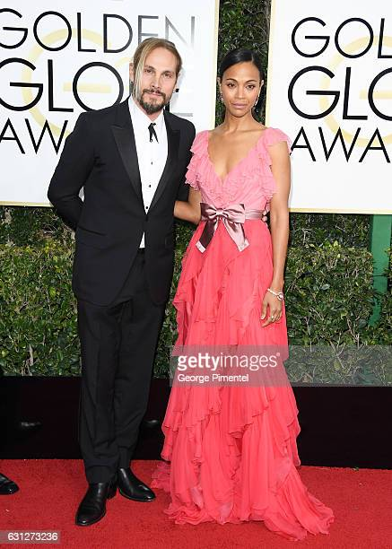 Artist Marco Perego and actress Zoe Saldana attend 74th Annual Golden Globe Awards held at The Beverly Hilton Hotel on January 8, 2017 in Beverly...