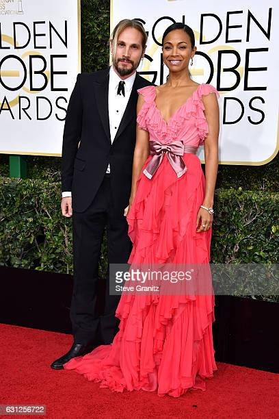 Artist Marco Perego and actress Zoe Saldana attend the 74th Annual Golden Globe Awards at The Beverly Hilton Hotel on January 8, 2017 in Beverly...