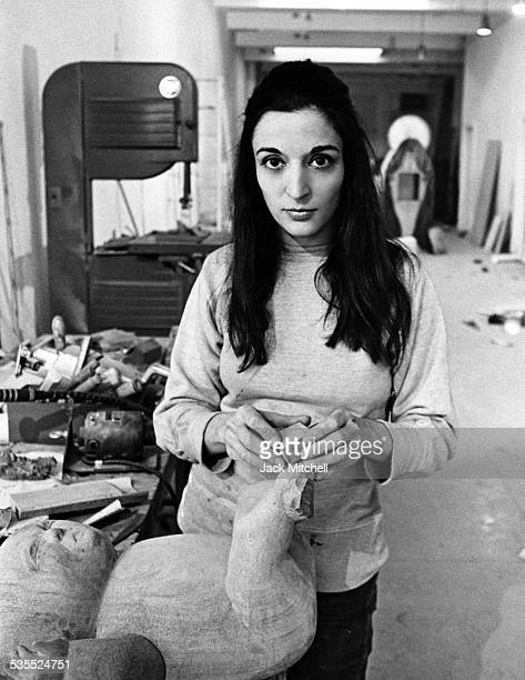 """Artist Maria Sol Escobar, known as Marisol, photographed in 1969 working on """"Holy Family""""."""