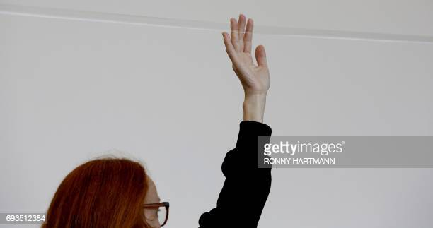 Artist Marie Cool performs with scotch tape during the Documenta 14 art exhibition in Kassel on June 7 2017 Documenta 14 takes place from April 8 to...
