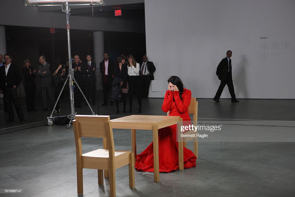 Artist marina abramovic performs during the marina abramovic the is picture id101555747 artist marina abramovic performs during the marina abramovic the artist is present exhibition thecheapjerseys Image collections