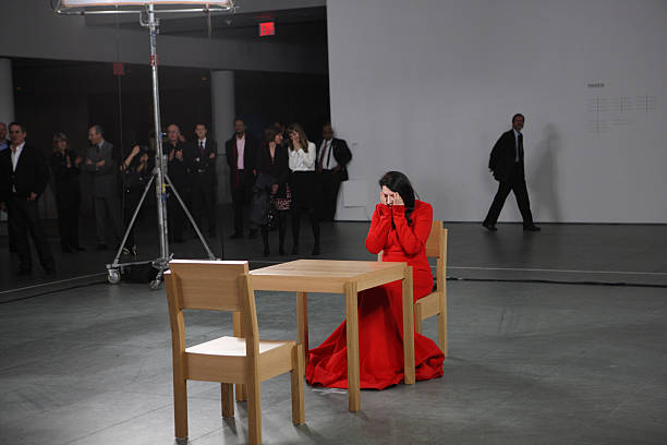 Marina abramovic the artist is present exhibition opening n10 artist marina abramovic performs during the marina abramovic the artist is present exhibition altavistaventures Image collections