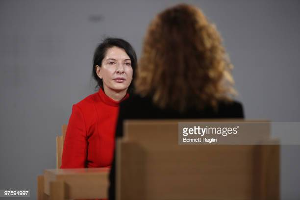 Artist Marina Abramovic performs during the Marina Abramovic The Artist is Present exhibition opening night party at The Museum of Modern Art on...