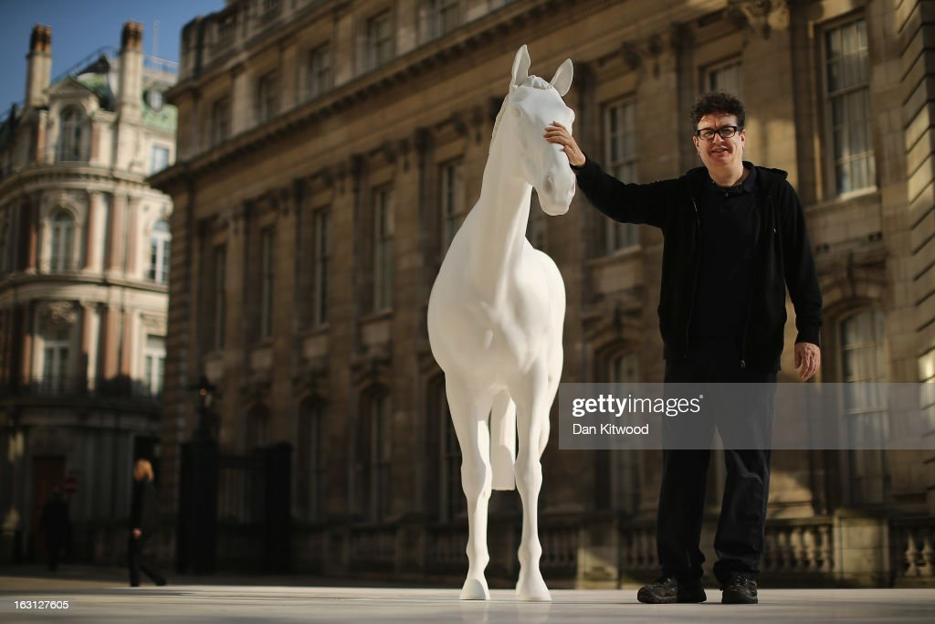 Artist Mark Wallinger poses beside his new sculpture 'The White Horse' outside the headquarters of The British Council on the Mall on March 5, 2013 in London, England. The British Council unveiled the marble and resin, life-size sculpture representing a thoroughbred racehorse, as it announced a GBP 7 million investment in work connecting UK-based creative talent overseas.