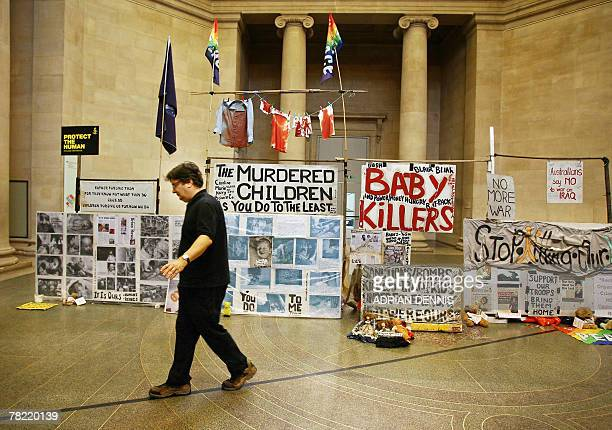 """Artist Mark Wallinger walks a """"metaphorical line"""" representing the one kilometre exclusion zone surrounding London's Parliament Square beside his..."""