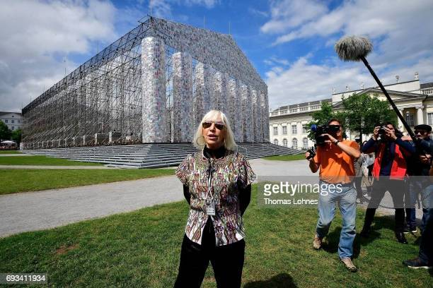 Artist Marta Minujin stands in front of her artwork 'The Parthenon of Books' on June 7 2017 in Kassel Germany The documenta 14 is the fourteenth...