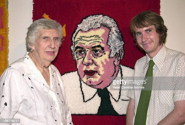Artist Martin Wilson with Margaret Whitlam and his artwork titled 'Fuzzy Prime Minsiters of Australia' depicting former Prime Minsiter Gough Whitlam...