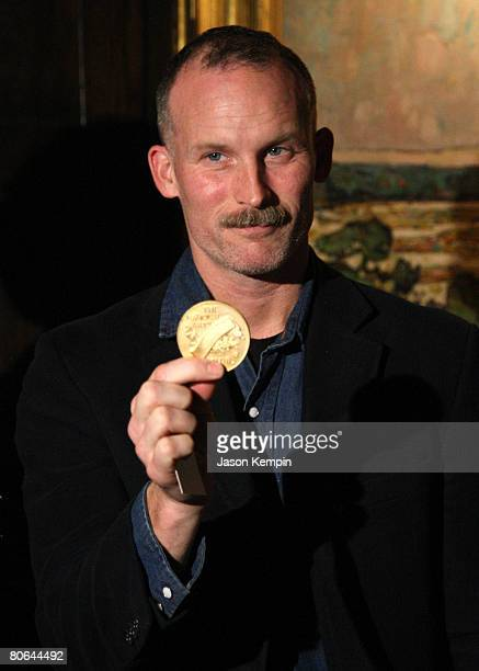 Artist Matthew Barney poses for photos during a reception where he was awarded the Visual Arts Medal of Honor at The National Arts Club on April 11,...