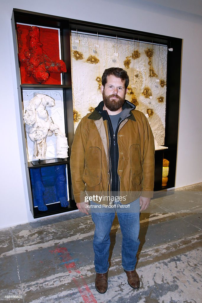 Artist Matthew Day Jackson poses in front of his work during the 'New American Art', Exhibition of Artists Matthew Day Jackson and Rashid Johnson, Opening Cocktail at Studio des Acacias on October 20, 2015 in Paris, France.