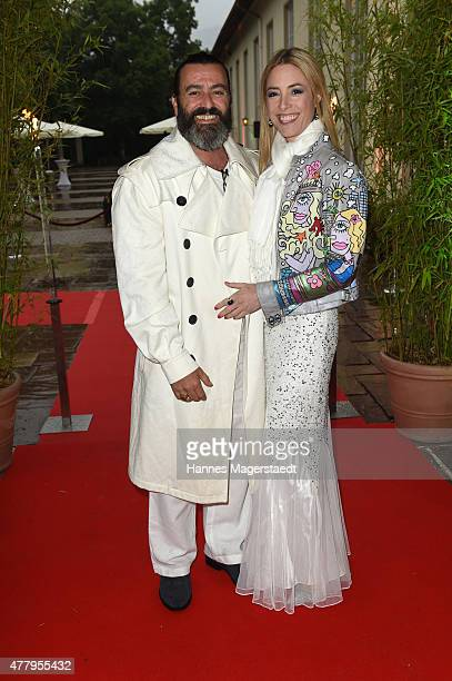 Artist Mauro Bergonzoli and his girlfriend Franziska Countess Fugger von Babenhausen attend the Jaguar White Night at Wandelhalle Bad Wiessee on June...