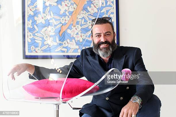 Artist Mauro Bergonzoli and his love chair during the Mauro Bergonzoli Country Life Studio Opening on May 30 2015 in Kirchheim Germany