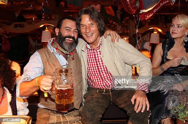 Artist Mauro Bergonzoli Hans Wilhelm Mueller Wohlfahrt during Oktoberfest at Kaeferzetl/Theresienwiese on October 5 2014 in Munich Germany