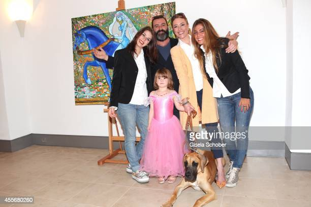 Artist Mauro Bergonzoli with his daughters Sarah Blue partner Franziska Fugger Babenhausen his daughter Gioia and dog Ding Ding attend the Exhibition...