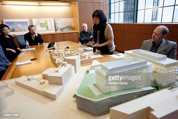 Artist Maya Lin center talks to a Globe reporter about a 3D model of the area where a new Novartis AG structure will be built In the foreground is...