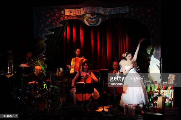 """Artist Meret Becker, accompanied by her """"the tiny teeth band"""", performs in the cabaret premiere: 'The fabulous variete show' during the reopening of..."""