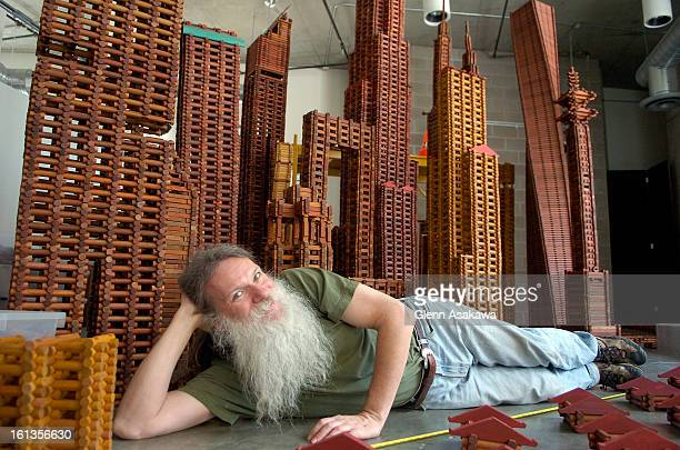 AELINCOLNDENVER COLORADO MAY 16 2007 Artist Michael Ensminger <cq> lays in front of his Lincoln Log city he created called the Tower of Babel at the...