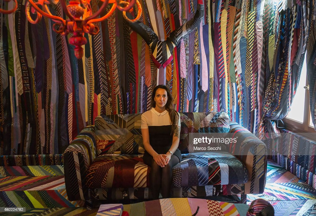 Artist Michal Cole poses for a picture inside her installation 'Top Gun' a room entirely decorated with twenty five thousand neck ties on May 12, 2017 in Venice, Italy. The 57th International Art Exhibition of La Biennale di Venezia will be open to the public from May 13 to November 26, 2017.