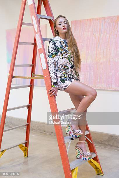 Artist Millie Brown poses at Millie Brown Rainbow Body on April 9 2015 in Los Angeles California