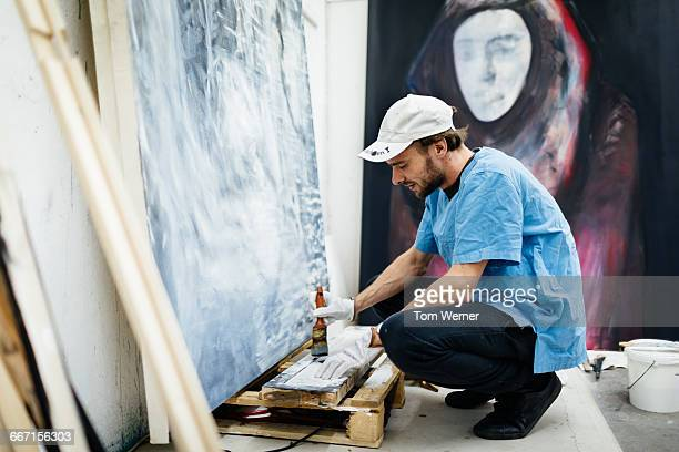 Artist mixing color in his atelier