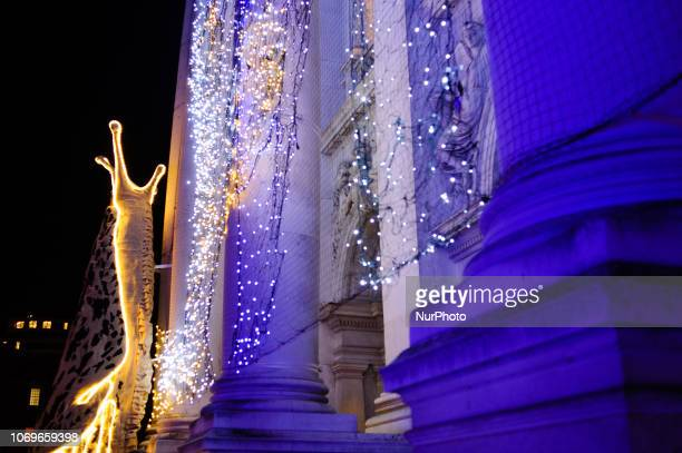 Artist Monster Chetwynd's giant illuminated slugs installation adorns the facade of the Tate Britain art gallery in London England on December 7 2018
