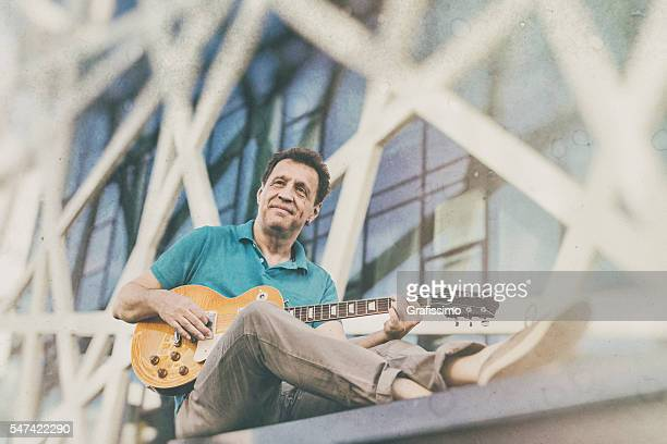 Artist musician playing the guitar outdoors