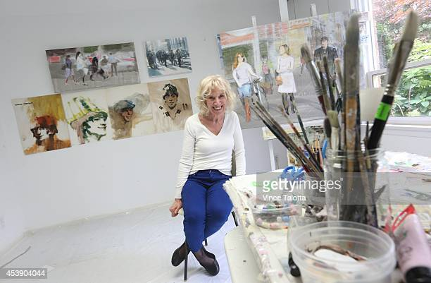 Artist Myra Lowenthal who in 1964 painted a series of art pieces of the Beatles as a fan in her studio with old Beatles paintings out of oil and new...