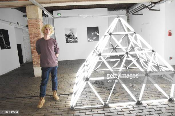 Artist Nelson Pernisco poses with his pyramid during the 'Hors Cadre' Exhibition Gallery Opening Preview on February 9 2018 in Paris France