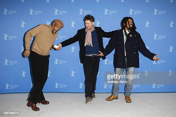 Artist Neville Garrick dances as director Kevin Macdonald and Rohan Marley look on at the Marley Photocall during day four of the 62nd Berlin...