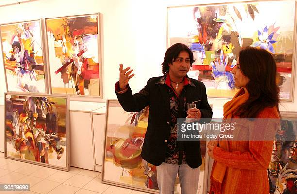 Artist Niladri Paul taking to a lady during his painting exhibition named 'Concert of Colours' at Santushti Shopping Arcade New Delhi