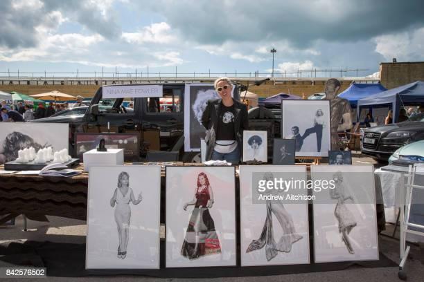 Artist Nina Mae Fowler selling her work at the 2017 Art Car Boot Fair Folkestone Kent