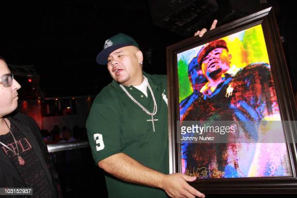 Artist Noah G Pop presents Fat Joe with the Fat Joe potrait at Club Perfections on July 28 2010 in the Queens borough of New York City