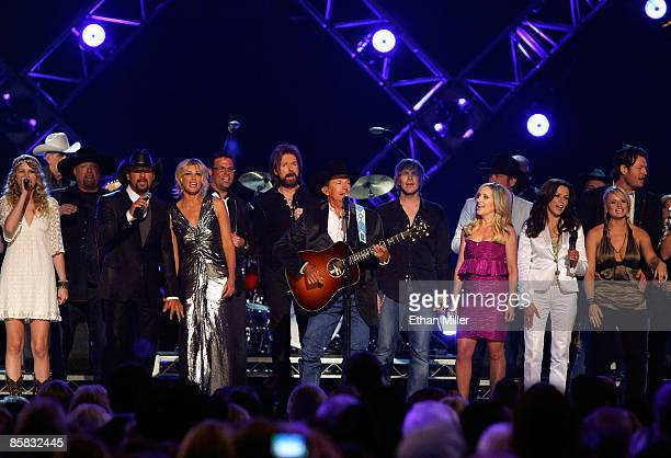 Artist of the Decade award winner George Strait performs onstage with Taylor Swift Eddie Montgomery Tim McGraw Faith Hill Troy Gentry Kix Brooks Jack...